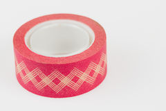 Roll of red washi tape. Roll of red gingham washi tape  on white background Stock Images