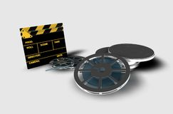 Clapperboard and reel of film. A roll or reel of film, in the film context, indicates the exact amount of film in a copy of a film Royalty Free Stock Images