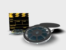 Clapperboard and reel of film. A roll or reel of film, in the film context, indicates the exact amount of film in a copy of a film Stock Photo