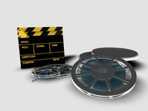 Clapperboard and reel of film. A roll or reel of film, in the film context, indicates the exact amount of film in a copy of a film Stock Photography
