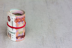 Roll Russian banknotes on a gray background Royalty Free Stock Photos