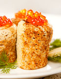 Roll from russian pancake with salmon caviar Stock Photo