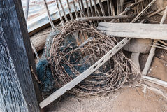 Roll of Rusty Barbed Wire and Dirty Nylon Net Stock Photos