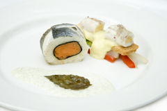 Roll of salmon. And halibut with rolls of shrimp, vegetables, bread croutons and a creamy sauce Stock Images