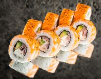 Roll with salmon, bacon and avocado Stock Images