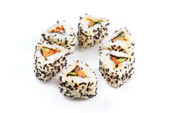 Roll with salmon, cucumber and sesame. Stock Photography