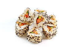 Roll with salmon, cucumber and sesame. Stock Photos