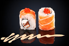 Roll salmon, eel, caviar, cream cheese and spicy sauce Royalty Free Stock Image