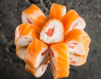 Roll with salmon, grapefruit and cream cheese. Over concrete background Royalty Free Stock Photo