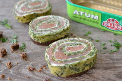 Roll of salmon and spinach. Salmon and spinach roll on a slice of pumpernickel bread Stock Image