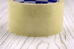 Roll of scotch tape on white . stock photo