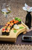 Roll set served on a wood plate Stock Photo