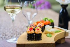 Roll set served on a wood plate Stock Photos