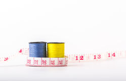 Roll sewing thread colors include yellow, blue and line measurem Royalty Free Stock Image