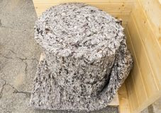Roll of sheep wool insulation material. Roll of sheep wool ecological insulation material used for housing thermal and sound proofing stock photos