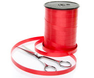 Roll of shiny red ribbon gift with scissors Stock Photography