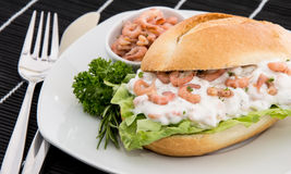 Roll with Shrimp-Salad on a cutting board Royalty Free Stock Image