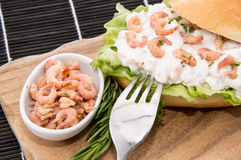 Roll with Shrimp-Salad on a cutting board Royalty Free Stock Photo