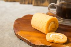 Roll small cake smells. Coffee with cream. Platters of brown and black coffee, ideal for breakfast, snacks and coffee breaks Stock Photography