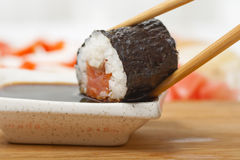 Roll in soy sauce. Close-up shot royalty free stock images