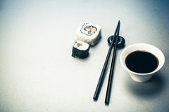 Roll, soy sauce and chopsticks Stock Photography
