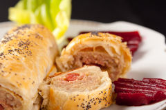 Roll of spicy sausage in flaky pastry Stock Photography