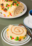 Roll sponge cake with fruit garnish Royalty Free Stock Photography