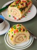 Roll sponge cake with fruit garnish Royalty Free Stock Photo
