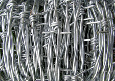 Roll of steel barbed wire Royalty Free Stock Photo