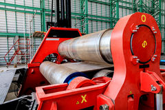 Roll steel plate machine. Roll steel machine red color in workshop stock images