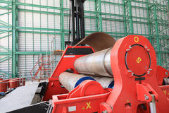 Roll steel plate machine. Roll steel machine red color in workshop royalty free stock photo