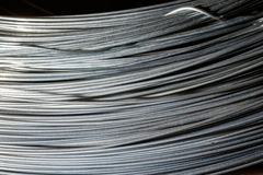 Roll of steel wire. In black background Royalty Free Stock Photography