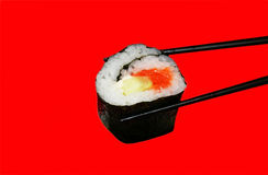 Roll sushi. Japanese sushi roll isolated on red background Stock Images