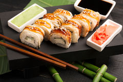 Roll sushi Dragon. With eel and rice stock image