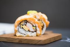 Roll sushi with salmon. Japanese sushi as healthy lunch royalty free stock image