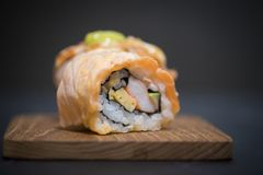 Roll sushi with salmon. Japanese sushi as healthy lunch royalty free stock photo