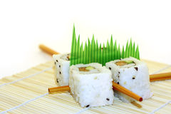 Roll Sushi structured over white. 4 rolls of sushi, in a zen attitude Stock Images