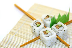 Roll Sushi structured over white. 4 rolls of sushi, in a zen attitude Stock Photo