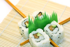 Roll Sushi structured over white. 4 rolls of sushi, in a zen attitude Royalty Free Stock Images
