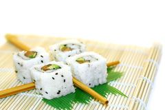 Roll Sushi structured over white. 4 rolls of sushi, in a zen attitude Royalty Free Stock Photography