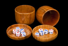 Roll them Dice. A pair of bamboo cups and dice often used for drinking games in Asia Royalty Free Stock Images