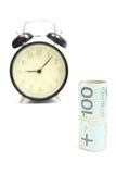 Roll of tied banknotes with retro styled alarm clock Stock Image
