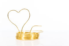 Roll tinker wire with shaped heart. In front of white Royalty Free Stock Photo