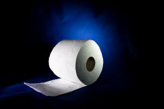 Roll of toilet paper. On the blue background Stock Images