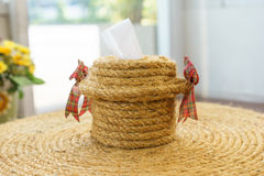 Roll of toilet paper, boxes made of rope. Royalty Free Stock Photos