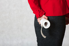A roll of a toilet paper in the hand of a young woman Royalty Free Stock Image