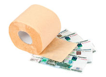 Roll of toilet paper and money Royalty Free Stock Photography