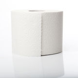Roll of toilet paper with reflection. Simple roll of no name toilet paper Royalty Free Stock Photo