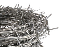 Roll up of barbed wire on white background Royalty Free Stock Photo