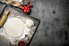 Roll up dough with ingredients for pizza. royalty free stock photos